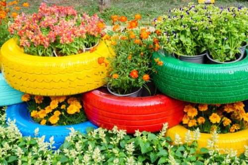 Colorful flowers growing in tyre pot containers. www.gromor.ie
